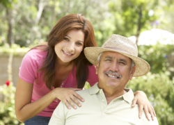 caregiver with old man smiling